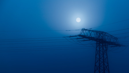 Power line at night and moon