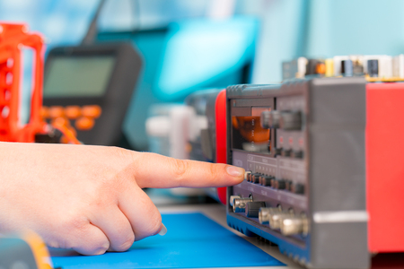 finger presses the button on the measuring instrument Stock Photo