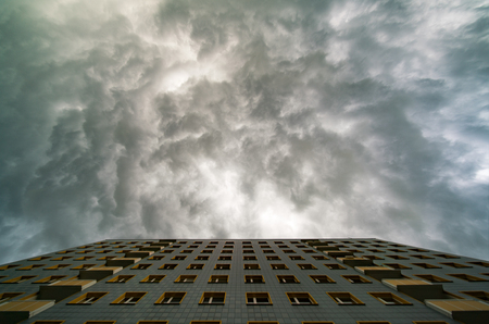 overcast: Facade of the apartment and a stormy sky