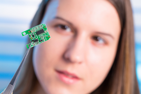 to mend: Young woman fix PC component in service center
