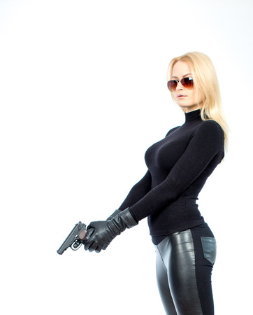 d95a8ed5e Woman With Gun Stock Photos And Images - 123RF