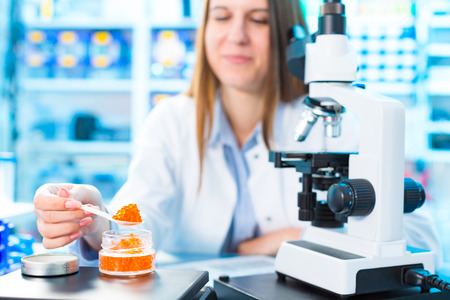 Fish caviar research in laboratory. Food Processing and Quality Control Fish