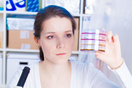 Female student with petri dishes photo