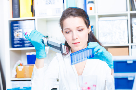 Female technician doing science experiment Stock Photo