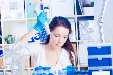 Female laboratory technician To do blood test in medical laboratory photo