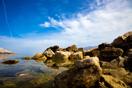 croatian: sea bay with a rocky coast in Croatia