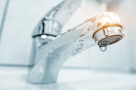 Water tap in bathroom Stock Photo