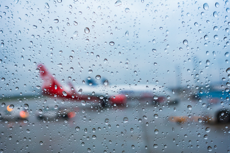 non: View from the airplane window in rainy non-flying weather rain