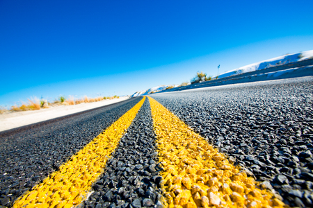Yellow stripes on asphalt road Stock Photo