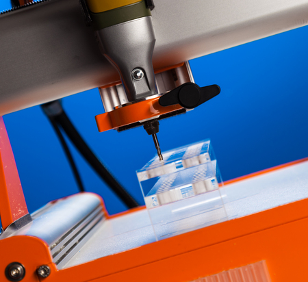 The milling machine processes the plastic blank Stok Fotoğraf