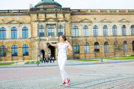 dresden: Girl makes photos shots of european city Dresden and selfie of background old German town