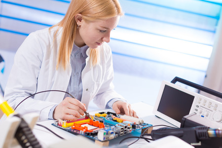 Young woman fix PC component in service center