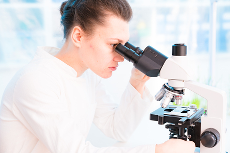 Young female technician in the laboratory of food quality control