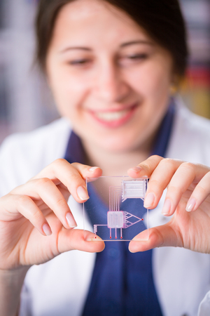 woman with LOC device (lab on chip)
