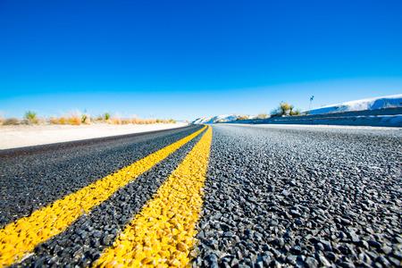 Yellow stripes on asphalt road Stock Photo