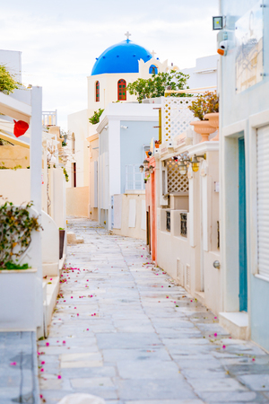 Oia town on Santorini island, Greece. Traditional and famous white and rose  houses at sunny day Stock Photo