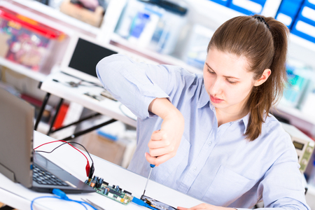 The girl in the lab with the hard drive HDD Stock Photo