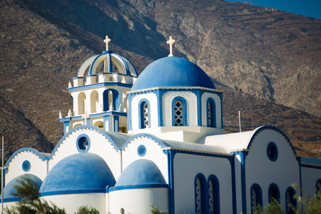 Orthodox Church on a background of mountains Stock Photo