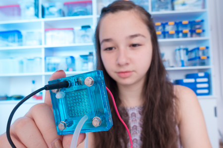 schoolgirl is experimenting with a hydrogen fuel cell Stock Photo