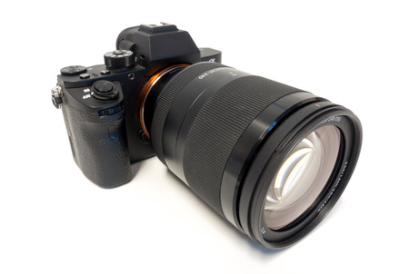 digital mirrorless photo camera with zoom lenses