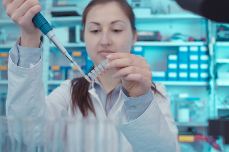 The girl in The laboratory of  genetics - reprogenetics Stock Photo