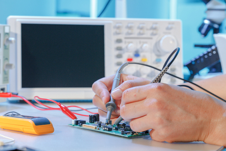 Repair of printed circuit boards with chips Фото со стока - 92906336