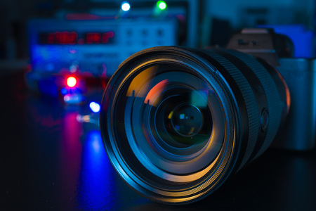 Photo Camera or Video lens close-up on black background DSLR objective Stock Photo