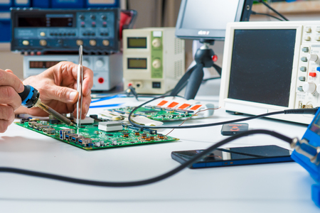 To repair the PCB of a modern monitor at the service center. Laboratory electronic processor technology 스톡 콘텐츠