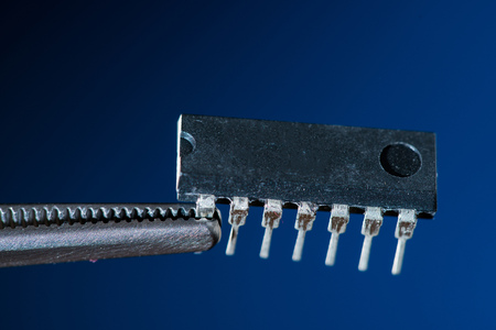Electronic chip isolated on dark blue