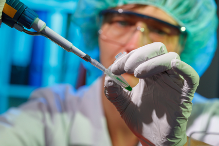 Female technician in laboratory of genetics - reprogenetics