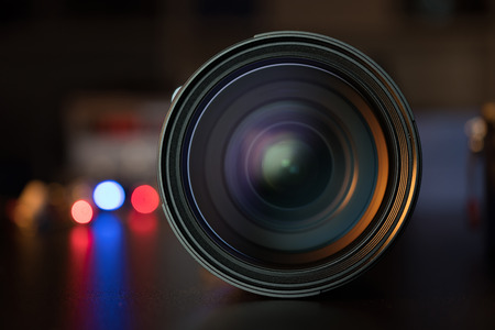 The photo or videocamera lens on dark background with lense reflections Stock Photo