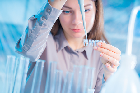 female technician with pipette in lad for DNA forensic testing Stock Photo