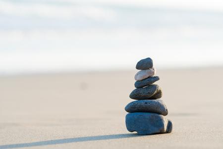 Zen stone little pile on sea beach 写真素材