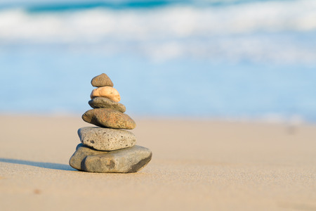 Zen stone little pile on sea beach 写真素材
