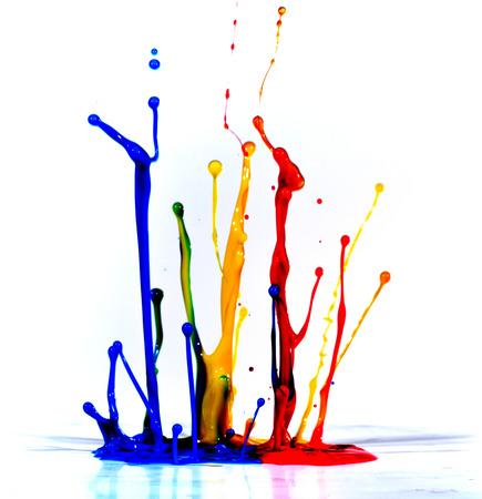 Isolated shot of paint splashing on white Stock Photo
