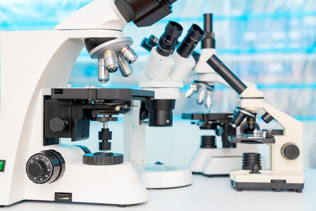 Four microscopes of different designs in the laboratory Stock Photo