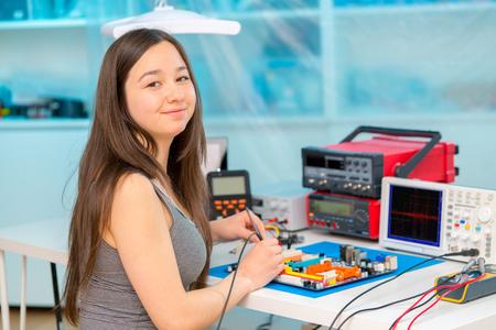 Girl in robotics laboratory. Stock Photo