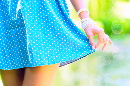 Girl holding the hem of the dress Stock Photo