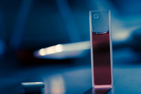 Quartz cuvette with the sample liquid for measurement Stock fotó