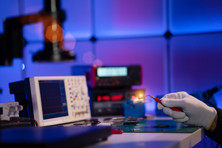 Check electronics device in industrial lab Stock Photo