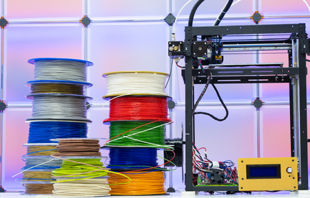 3D Printer and spools of plastic filaments
