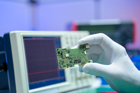 To repair the PCB of a modern monitor at the service center. Laboratory electronic processor technology Stock Photo