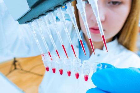 Girl lab technician at the clinics microbiology laboratory Stock Photo