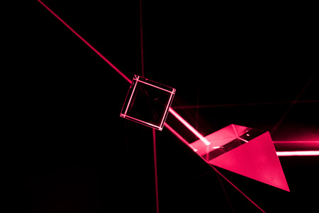 Laser beam and optical glass on black background