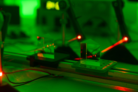 Experiment with a red laser in a physics lab