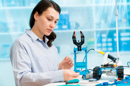 Young woman in CNC and robotics laboratory