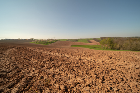 Agricultural plowed field in spring