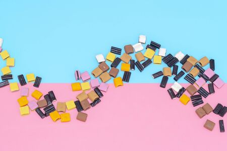 Liquorice  Candy on a pink and turquoise background flat lay 免版税图像