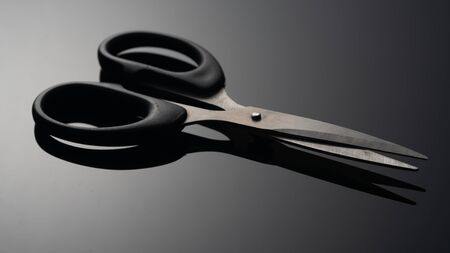 Scissors on black background