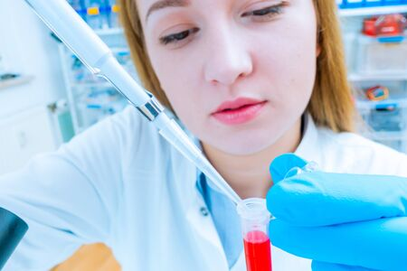 Girl lab technician at the clinics microbiology laboratory 写真素材